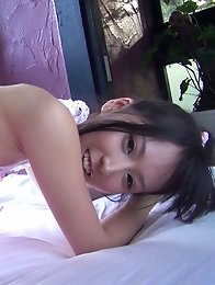 As the Director pulled Rinas thong down to her knees past her warm and tight little Japanese pussy lips, she just relaxed and enjoyed herself as her e