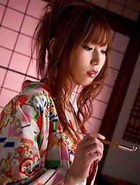 Sensual asian goddess takes off her kimono to show her big tits