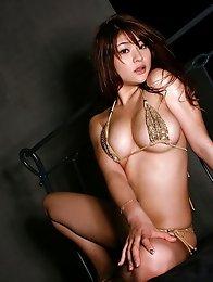 Sizzling hot gravure idol chick with big massive tits in a bikini