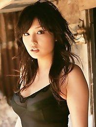 Captivating asian babe looks incredible in her black bikini