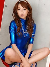 Sexy asian babe allures and seduces in a metallic blue skirt