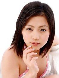 Japan gravure model Rion Sakamoto in a pink and white polka dot bikini
