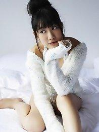 Sensual asian goddess looks incredible in her white bikini