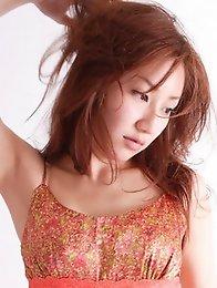 Long haired babe Remi Kawashima enchants in her pink dress