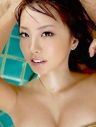 Sensual gravure idol babe Azusa Yamamoto enchants in her slinky wet shirt