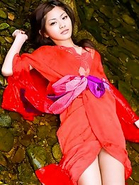Rika Sato Asian doll shows erotic curves in colorful bath suit
