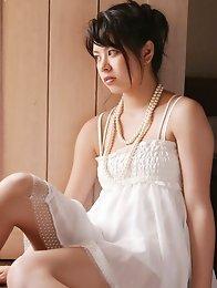 Kyoko Kamidozono busty shows ass in blue bikini in swimming pool