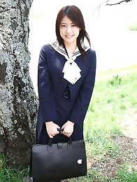 Saki Fukuda Asian in cute yellow dress tries to keep garden wet