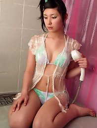 Gorgeous asian angel in sensual green lingerie taking a shower