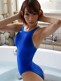 Lovely and sex Japanese av idol Kurea Hasumi shows off her sexy body wearing blue swimsuit