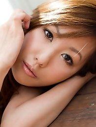 Redhead Japanese Natsuki Yoshinaga takes off her dress to show a nice body