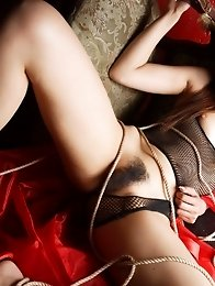 Blond japanese girl Nao Yoshizaki in latex lingerie