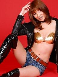 Kaori Minami shows off her sexy body in jean shorts and a bikini