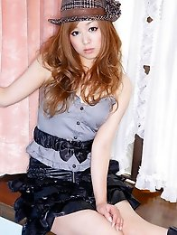 Red headed gravure idol cutie in a short skirt and boots