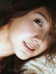 Megumi Yasu Asian cutie showing off her hot body in a bikini