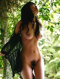 Yua Aida posing outside in her bra and panties