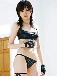 Sultry Akiko Seo showing off her curvy body in a leather bikini