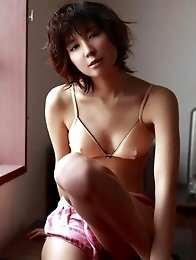 Miu Nakamura shows off her tiny tits in a pink bra and panties