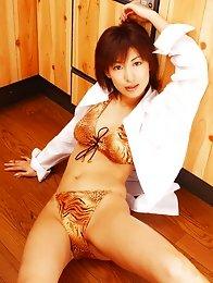 Mariko Okubo posing in her leopard print lingerie with stockings