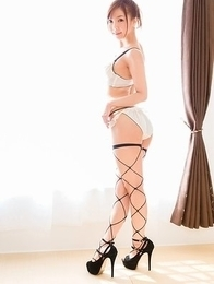 Fishnet-clad Mio Yoshida posing seductively in a very hot solo gallery