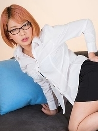 Glasses-wearing secretary Chie Kobayashi flashing her pussy on a couch