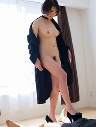 Short-haired goddess Akari Misaki shows her pussy before a great FootJob