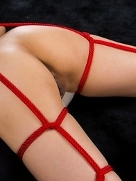 Red roped used to tie up Shizuka Maeshiro, she then gets teased with a vibrator