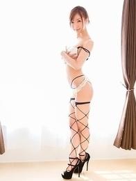 Fishnet-clad Mio Yoshida posing seductively in a very hot solo gallery
