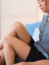 Mio Yoshida wearing a strict outfit during her hot footjob affair