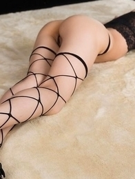 Fishnets-wearing brunette in heels Ayaka Mikami posing shamelessly on the floor