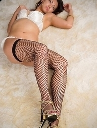 Fishnets-wearing beauty Misato Kagawa showing her ass in sexy white panties
