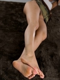 Karina Oshima showing her long legs and sexy soles while in a tiny skirt