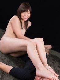 Aoi Shino toe-fucking a guy's throat in a femdom-y handjob gallery