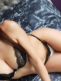 Fetish-addicted Asian Wakana Kinoshita poses in a tight corset