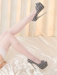 Airi Mashiro taking off her lingerie but leaving those sexy white stockings on