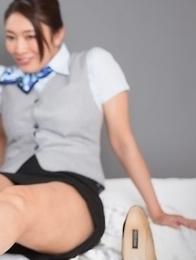 Stewardesses Reiko Kobayakawa and Ryu Enami give this guy a great footjob