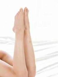 Skinny beauty Rio Kamimoto gives a great footjob in a really sensual scene here