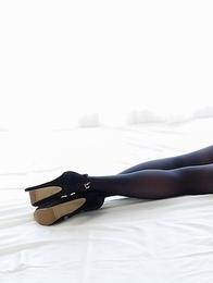 Natsuki Yokoyama posing in a red skirt with black stockings, showing her ass