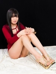 Lady in red Moeka Kurihara spreads her legs to show off the points of entry