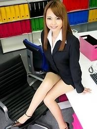 Sexy girl Saki posing in her office