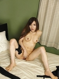 Hitomi Tsukishiro undresses to show hot boobs