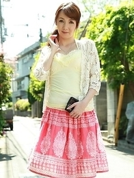Asian Chika Sasaki in pink and yellow outfit