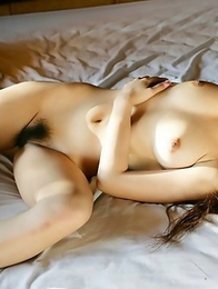 Asian Koisaya gets into a stunning nude photoshoot
