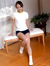 Japanese Luna posing and playfully stripping her clothes to show us her nice full bush