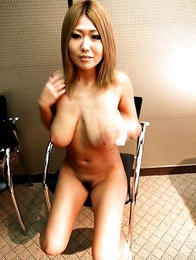 Pretty Japanese model Aimi strips down and lets her pair of extra large boobs hang