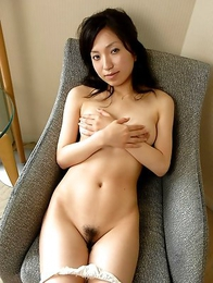Japanese model in a schoolgirl uniform Airi Nakajima stripping and spreading her legs