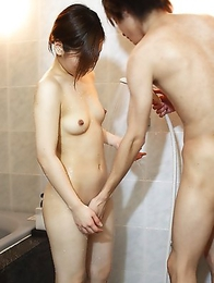 Cute Japanese girl Makoto Kurosaki stripping and giving us a handjob while taking a shower
