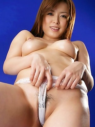 Rei fondles nasty tits with oil and exposes naughty behind