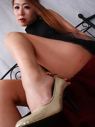 Miho Kuroki shows sexy legs under black dress in her bed
