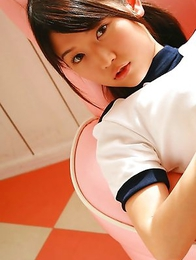 Noriko Kijima in sports equipment is playful in the house